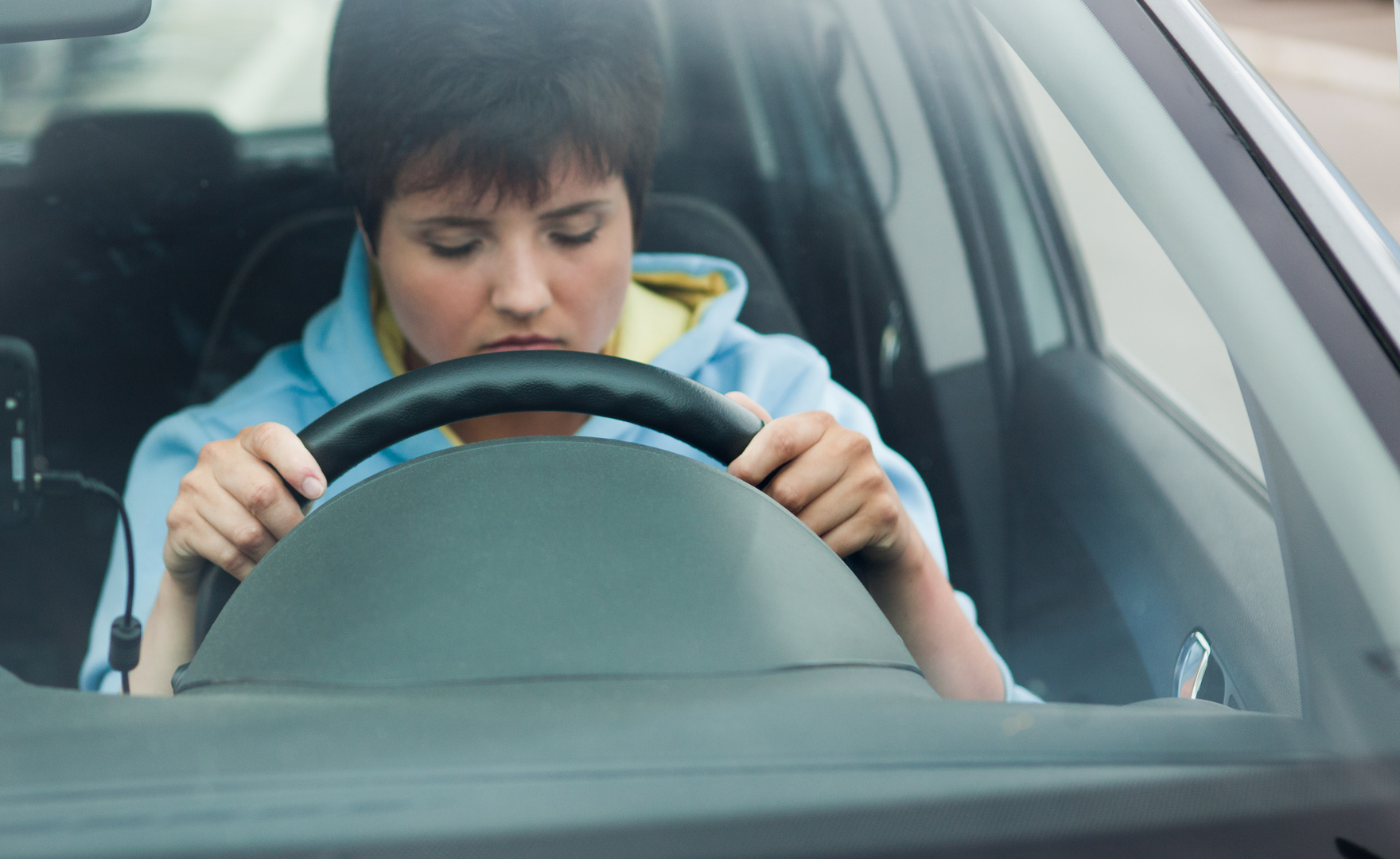 Woman dozes off while driving her car. If this happens to you, call a Flint auto accident lawyer.
