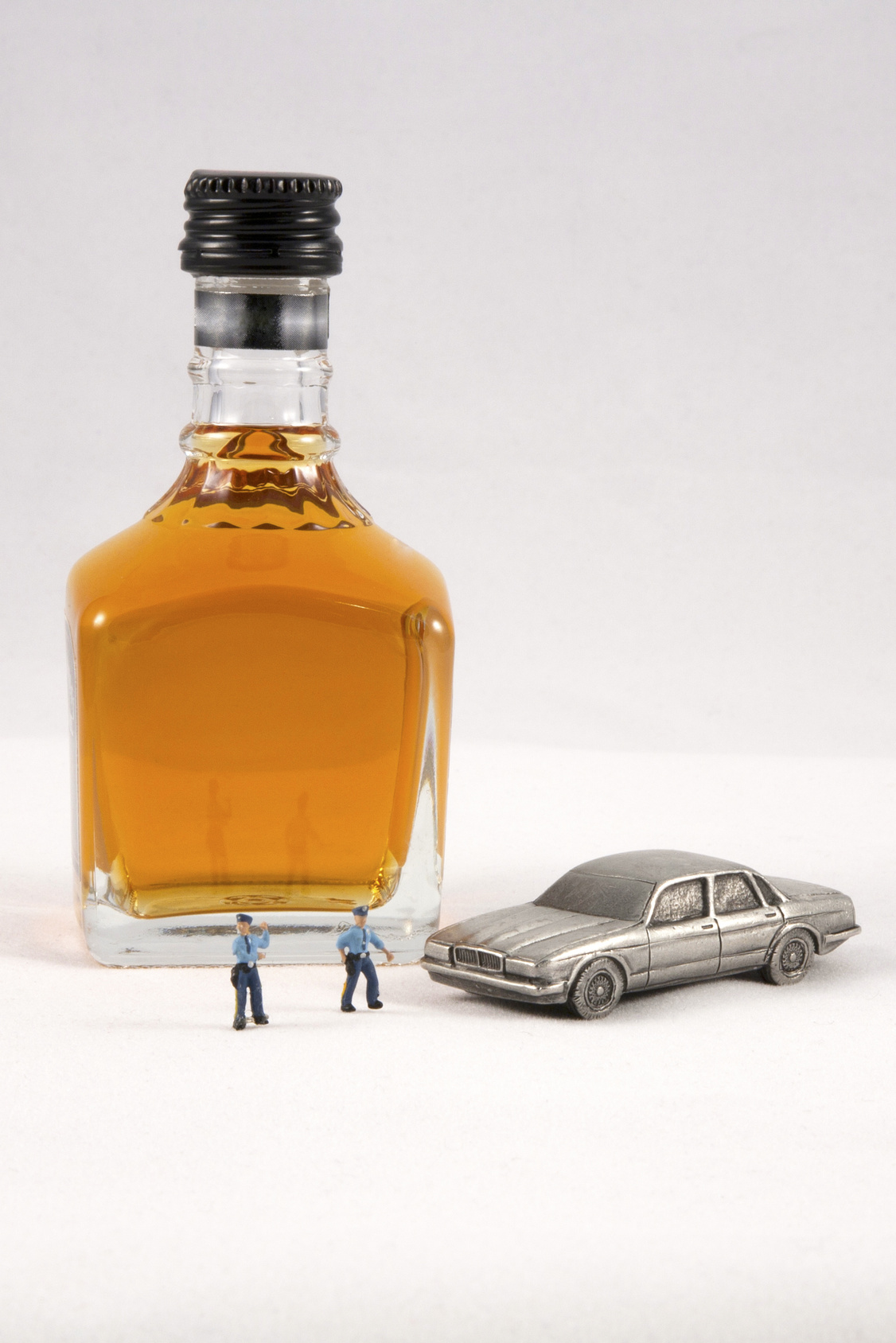 Drinking and Driving Concept and if you need a skilled DUI attorney look in Flint.