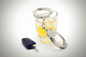 car keys with glass of whiskey if recently arrested with a DUI contact a skilled criminal defense attorney in Flint, MI