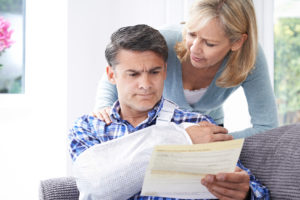 man reading claim about his injury from premises liability with Flint injury attorney