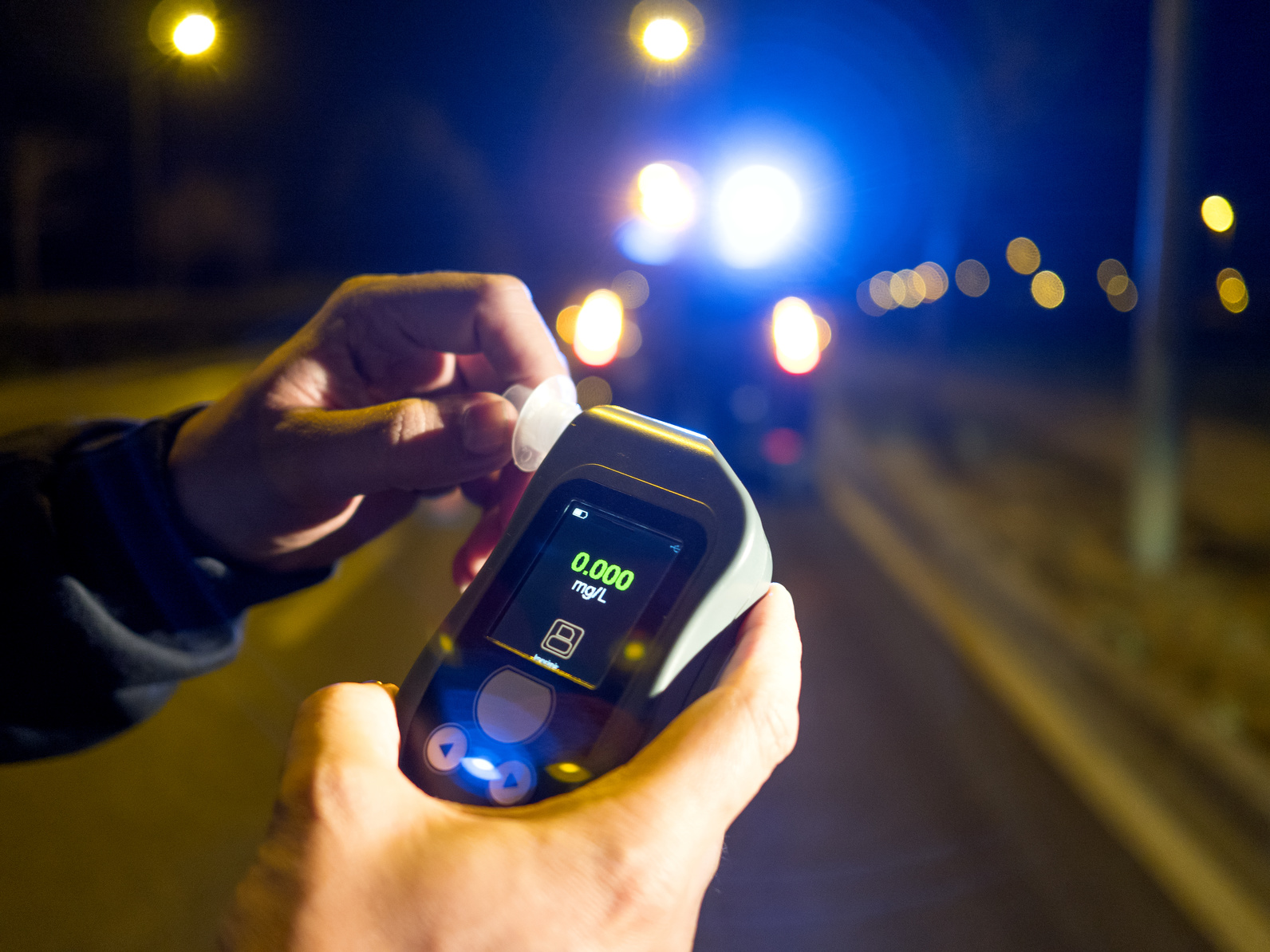 Alcohol breathalyzer test and if you need a good DUI attorney find one in Genesee County