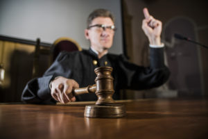 judge with gavel pointing