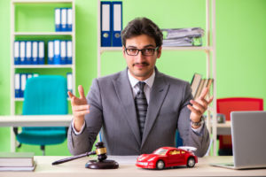 Attorney with a toy car and gavel