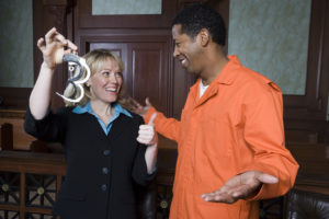 lawyer and client charged with felony celebrate their defense of case by reliable Grand Blanc criminal defense lawyer.
