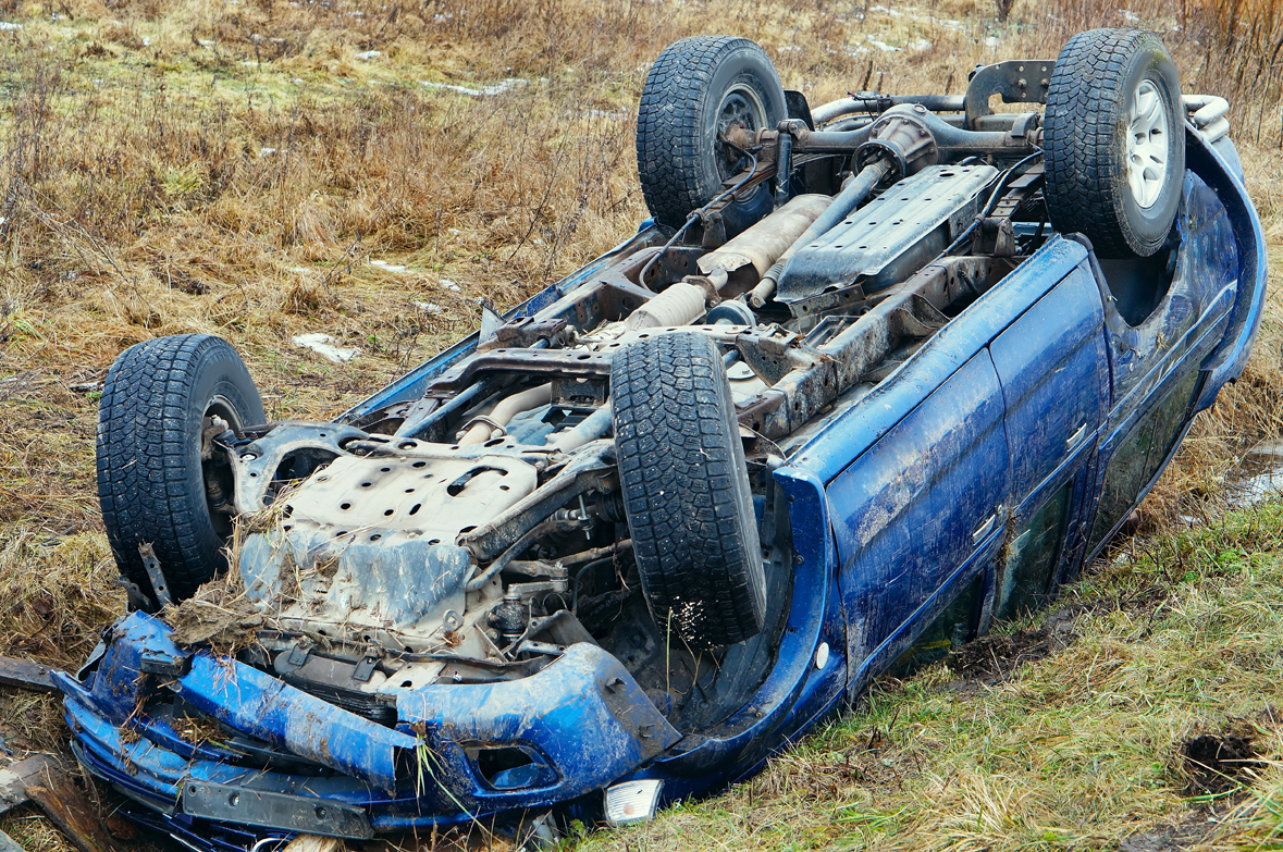 An upside down car from rollover accident, if injured and not at fault speak to a Car Accident Injury Attorney in Grand Rapids.