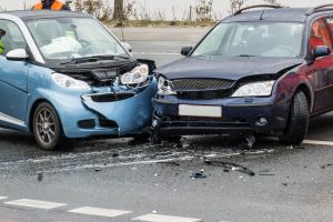 Two cars that got into an accident damaging both front bumpers. representing how one can benefit from calling a Burton auto accident lawyer.